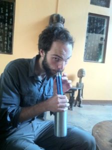 Nico using his Lifestraw in Uganda